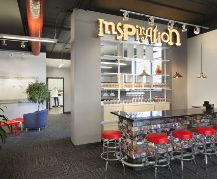 Commercial Office Space Interior Design Medium Space Eating Lunch Area - red topped barstools to sit at counter type table with inspirational wording and glass backed wall for fun interior design for eating