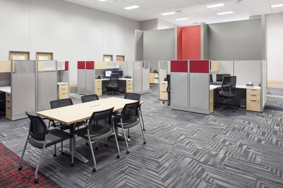 Commercial Office Large Workspaces with Open Feel - desks in shorter cubicles around outer edge and a meeting table in center