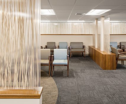 Healthcare interior design waiting room interior design - art pieces with modern linear look to ceiling that divide out room cleverly