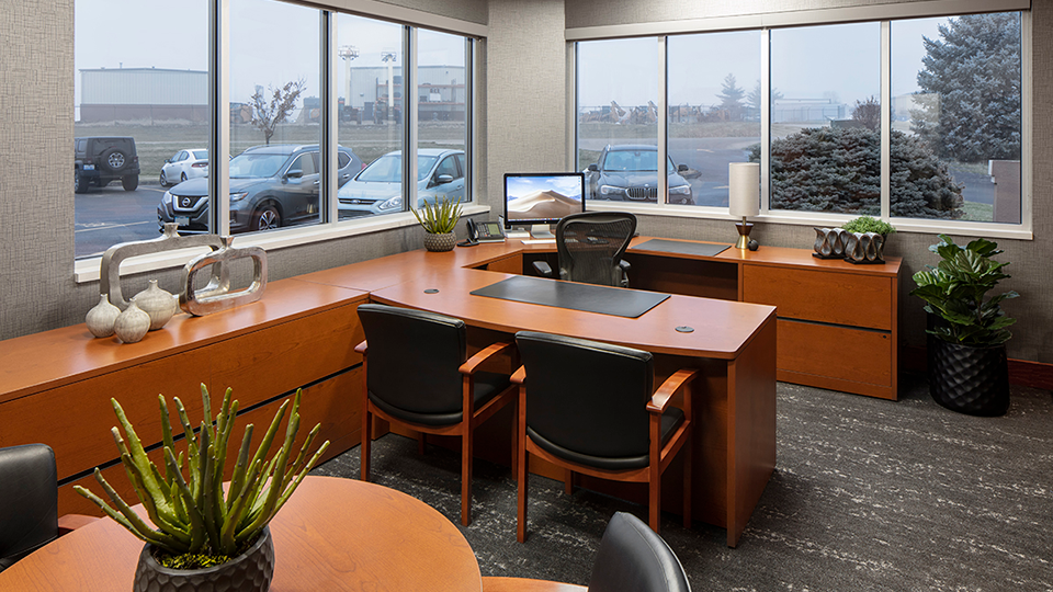Workspace office with brown tables and black leather details